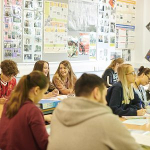 Students sat at desk in a History classroom Carmel College St Helens