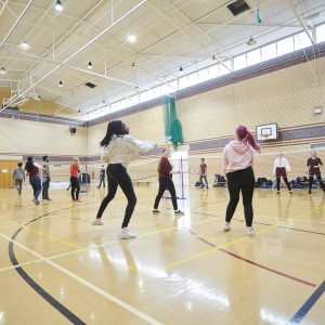 Students playing badminton in the Sports Hall Carmel College , St Helens